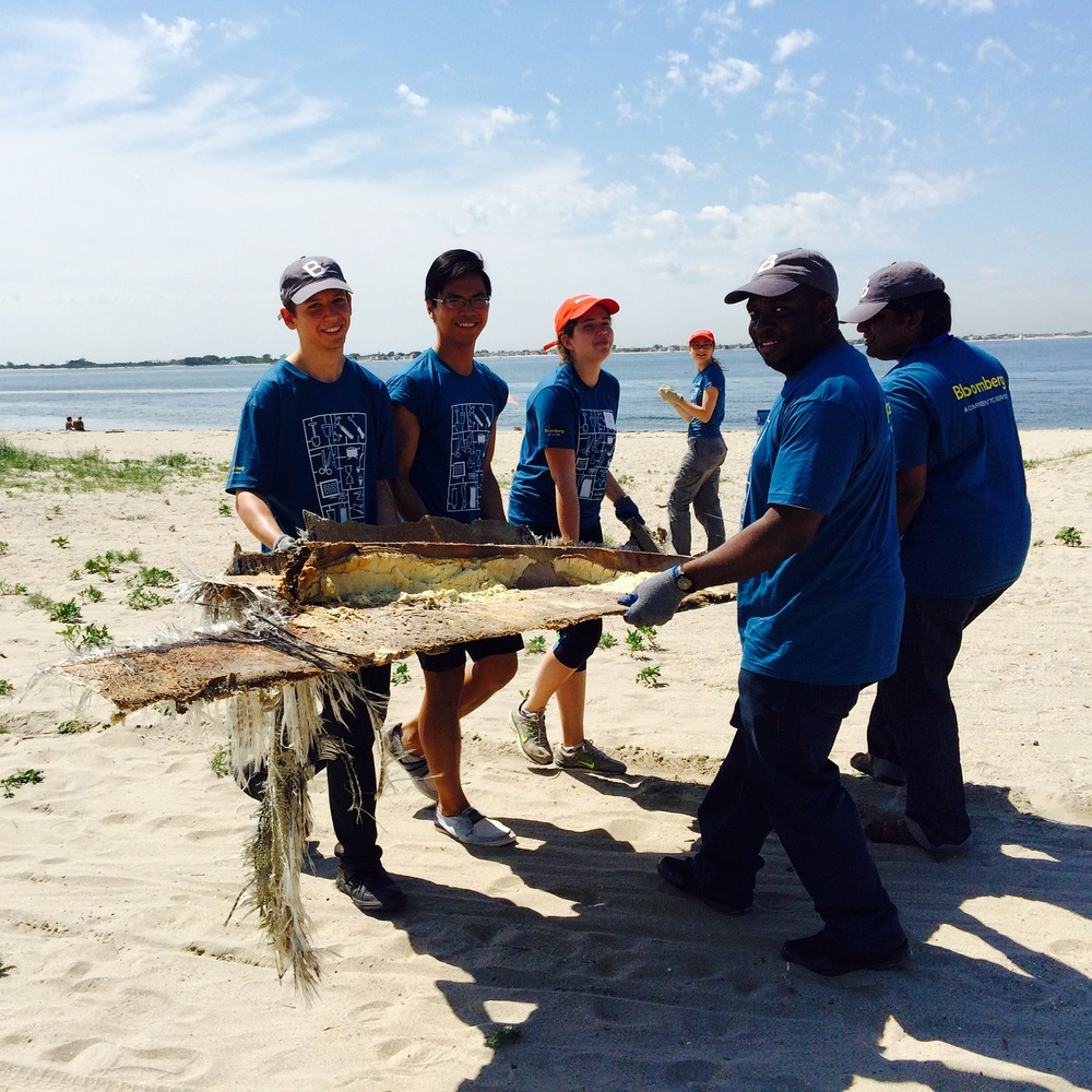 Volunteers remove maritime debris from Plumb Beach.