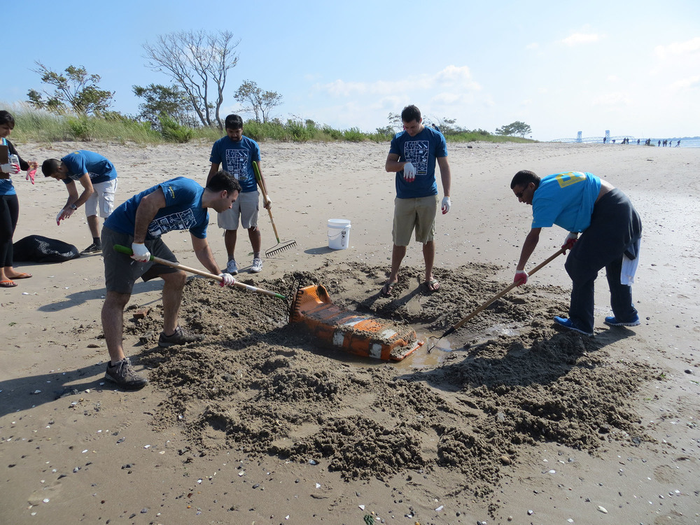 Volunteers remove 450 lbs of large-scale debris from Plumb Beach.