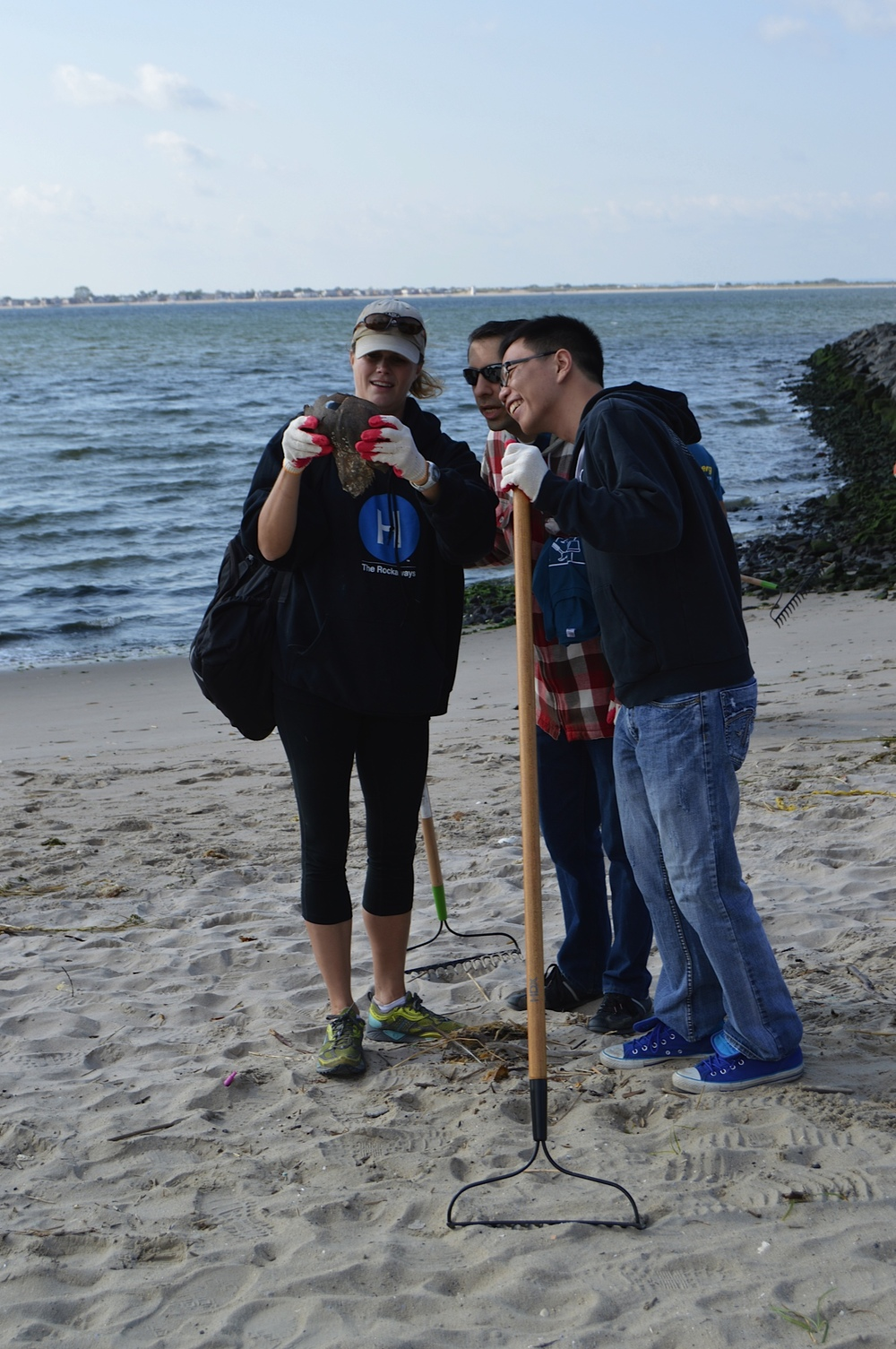 Volunteers at Plumb Beach learn about the wildlife and habitats they help to restore.