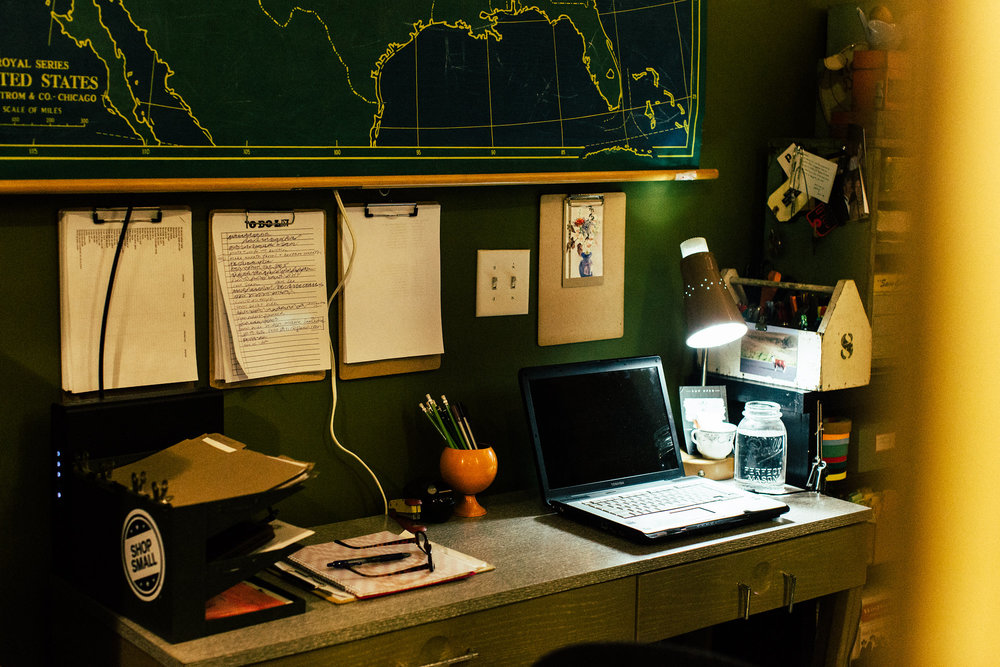 Christine's work space, we wouldn't mind hunkering down under that dreamy map!