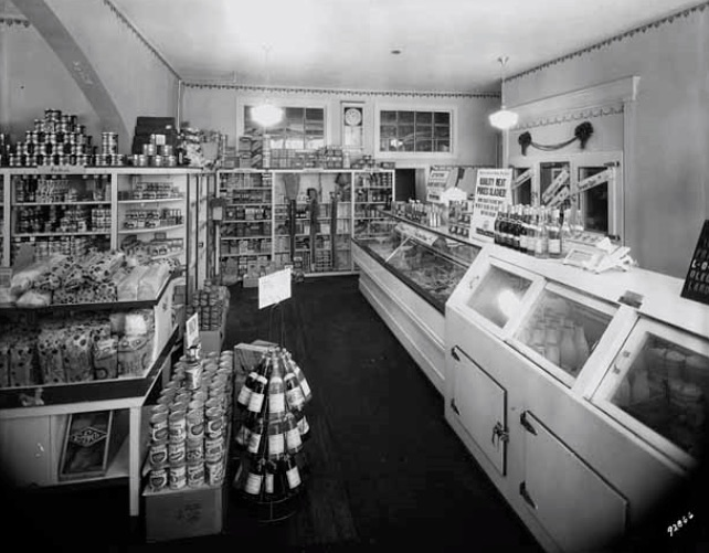 The Farmhouse's previous life as a convenience store circa 1931. The walk-in cooler that now serves as the mushroom incubator can be seen above in the rear right-hand side behind the counters.   Photo provided by Martin Gordon