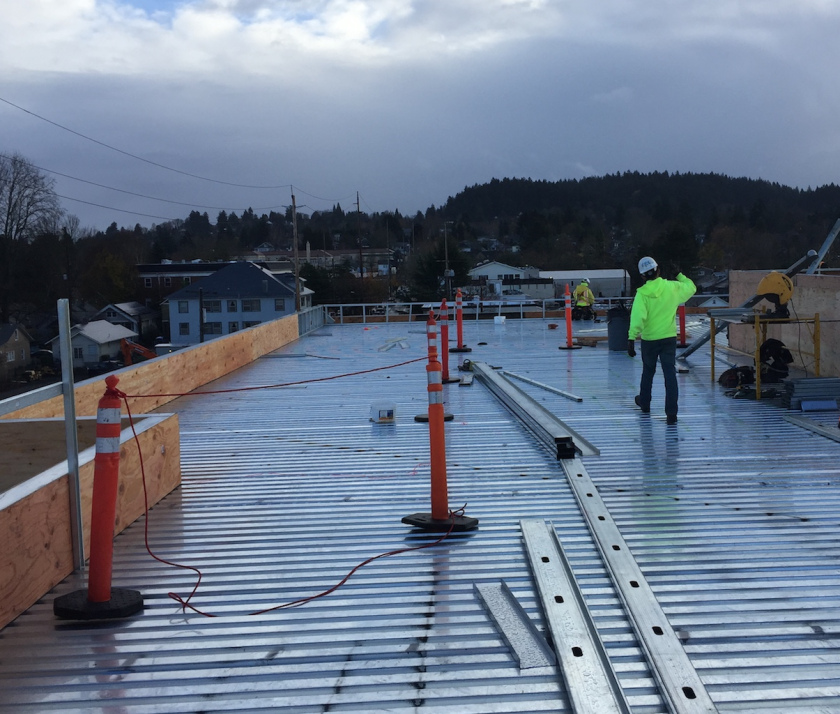 Members of the PDX Commons construction team installing the roof in late November.
