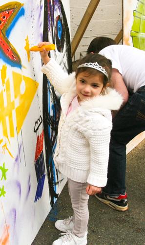 GraffitiJam2013_LittleGirlPainting_2.jpg