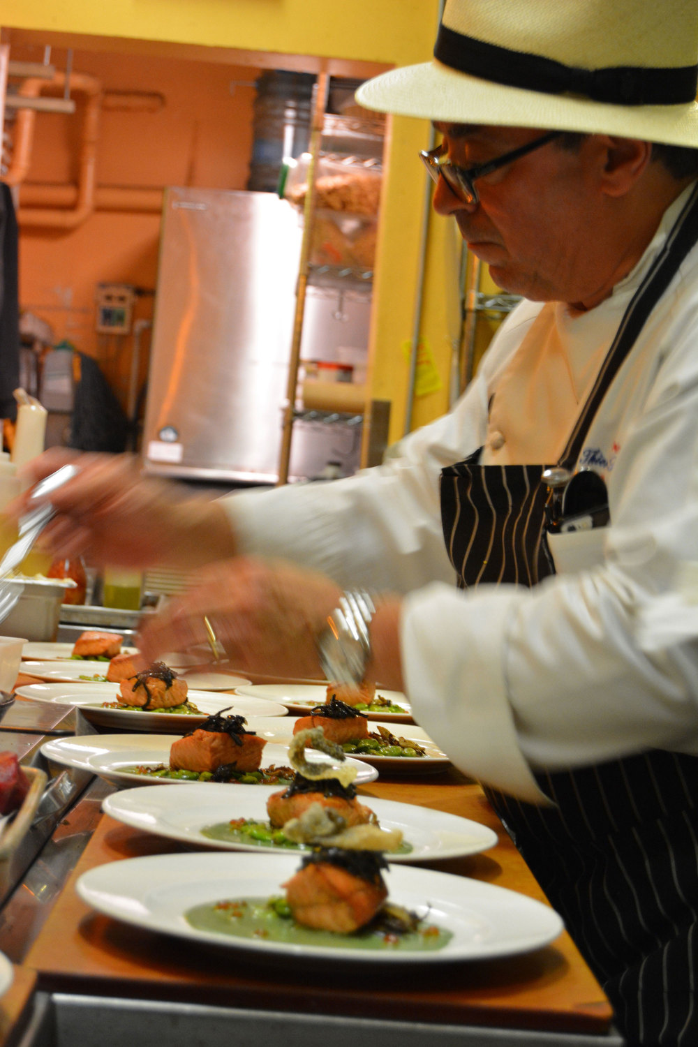 Chef Thierry plating salmon