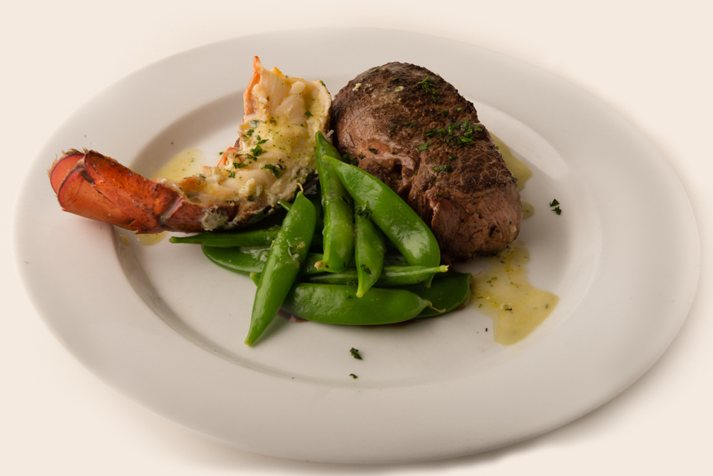 ABSOLUTELY LOBSTER® SURF n TURF  With supporting players of a juicy filet and freshly steamed snap peas, Absolutely Lobster® tail completes the cast of a perfect Surf n Turf!