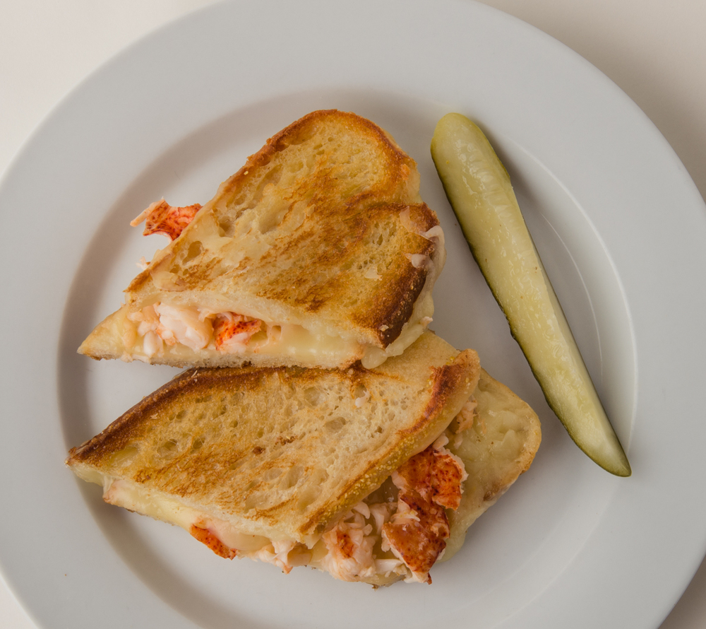 ABSOLUTELY LOBSTER® GRILLED CHEESE  How do you build a better Grilled Cheese Sandwich?  Add any flavor Absolutely Lobster® tail meat and hunker down to a mighty meal!