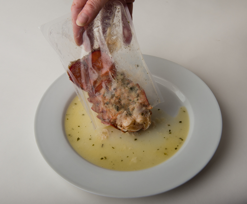 Pour the cooked Absolutely Lobster® tail and sauce onto the plate or bowl.