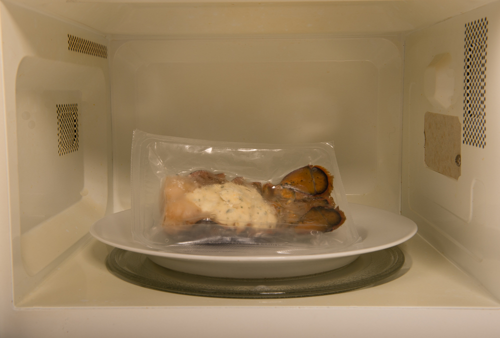 Place the pouch shell-side down on a microwave-safe plate or bowl -- or use the Absolutely Lobster®  tail tray.