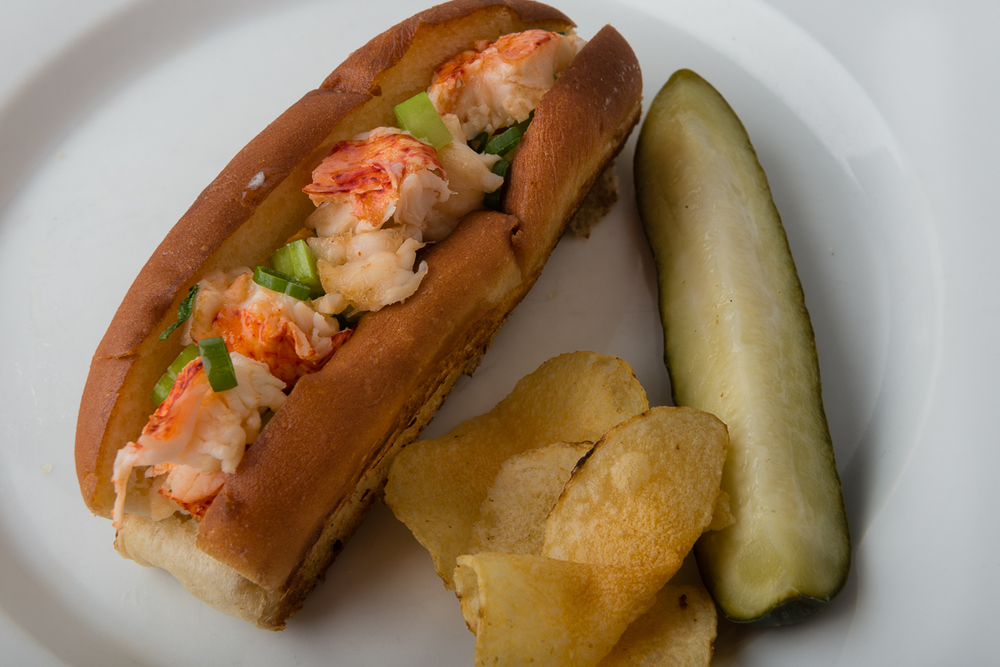 ABSOLUTELY LOBSTER® CLASSIC ROLL  Mix lobster tail meat and buttery sauce with celery and scallions and serve on a toasted bun for great take on a summer classic!  Garnish with pickle and chips.
