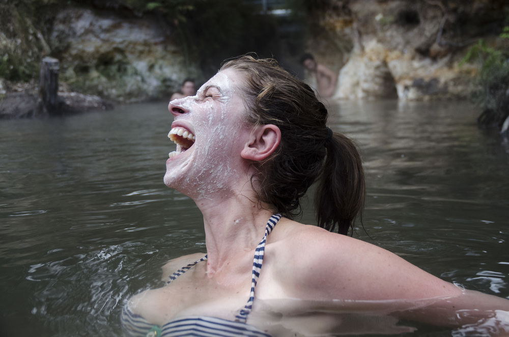Local hotspring in Rotorua, North Island, New Zealand. Clay mask from natural deposits pictured behind.