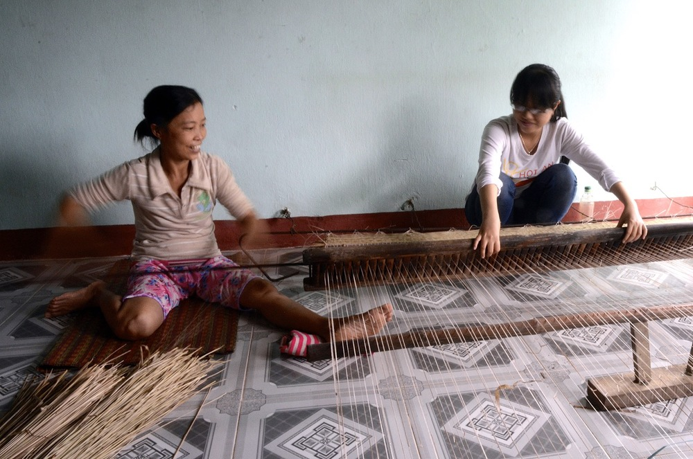 Weaving sleeping mats.