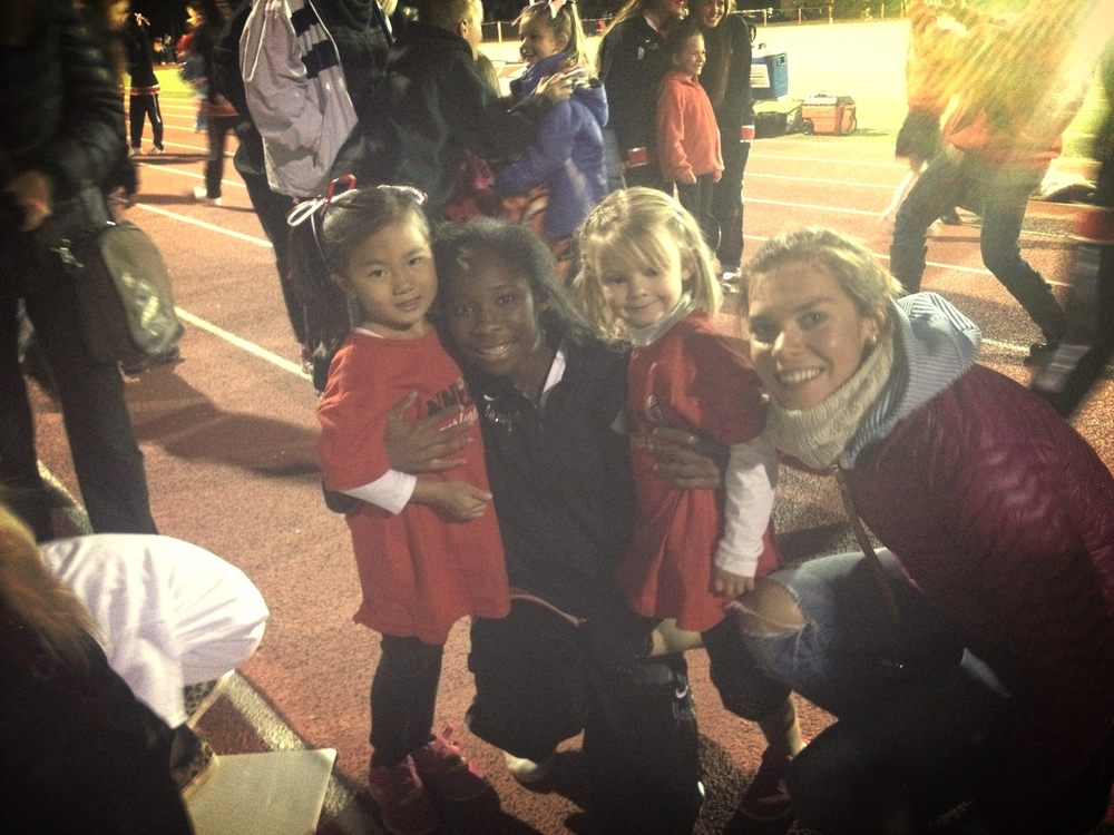 Getting to know a coupla cutie pie cheerleader performers at the football game