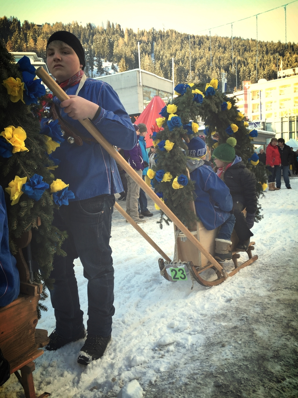 Davos is celebrating 150 years since the first winter guests came to take in the views. Local kids taking part in a decorated schlitten tour on the promenade.