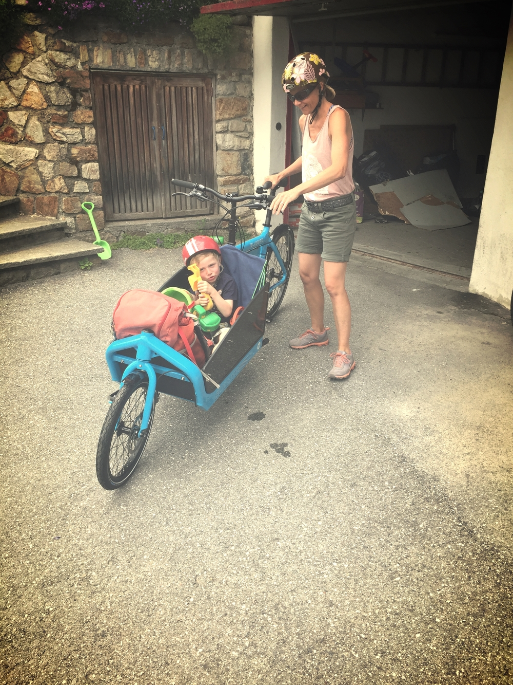 Mama Barbara taking Maurin out for a spin in Blue Bird. Cool cargo bike!