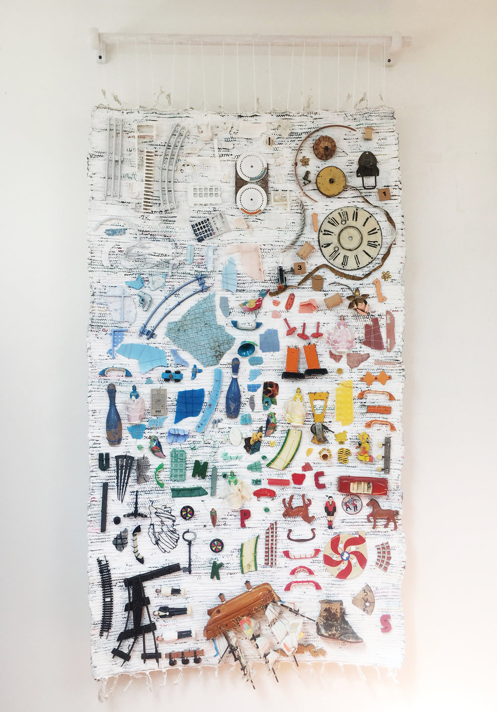 """Constellations Of Scattered Bones & Hand Me Down Snippets,  2018, Gessoed Rug, Found & Collected Objects, Beach Plastic from the North Shore of O'ahu, Hawaii, Thread, Wooden Dowell, Hooks, 67"""" H x 36"""" W"""