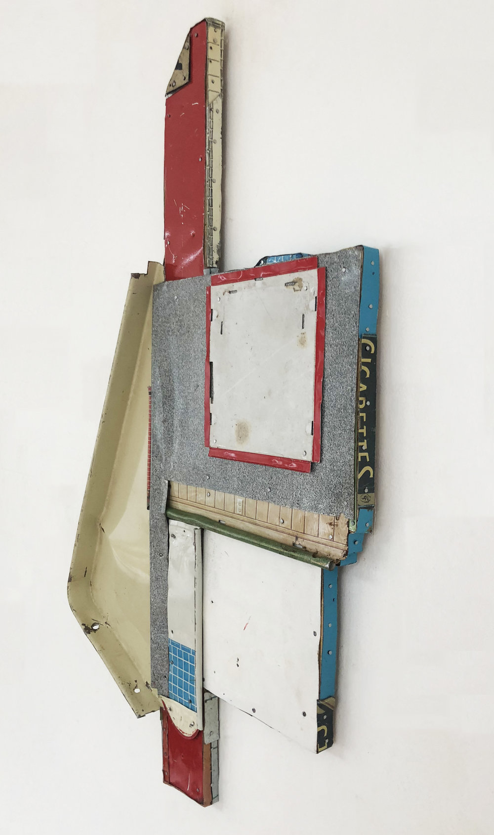 """Sideview of  The Important Non Places,  2017-18, Tin, Nails on Shaped Panel, 21"""" H x 13"""" W x 1"""" D"""