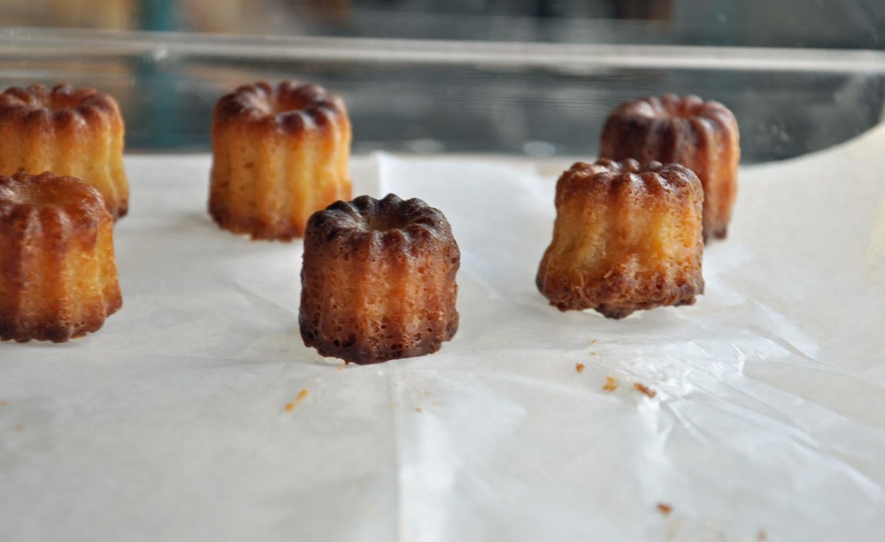 CANELE - THE ORIGIN OF THIS CONFECTION DATES BACK TO A CONVENT IN THE BORDEAUX REGION OF FRANCE BEFORE THE FRENCH REVOLUTION. NUNS PREPARED THE LITTLE CAKE FOR ORPHANS. THE BAKERY MAKES THIS UNIQUE PASTRY THAT CARRIES AN AROMA RICH WITH THE FRAGRANCES OF VANILLA, CARAMEL, BEESWAX AND HISTORY.