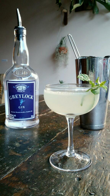 The Southside: Greylock Gin, Lime, Simple Syrup and Mint.  Shake ingredients together.  Strain through a tea strainer into a coupe and garnish with a sprig of mint!  A gimlet variation as shared by Mary Vaughan at Allium in GB/ Photo courtesy Mary Vaughn