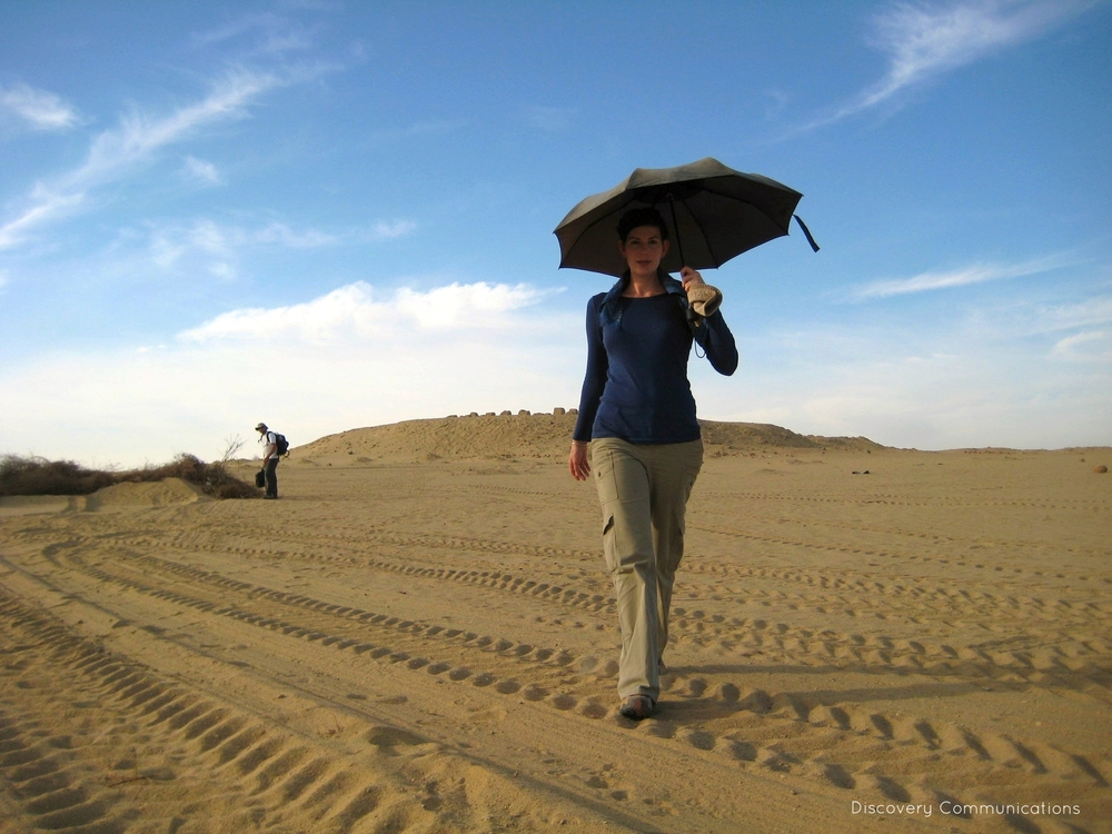 "Kara Cooney, walking in a desert in Egypt while filming ""Out of Egypt."""