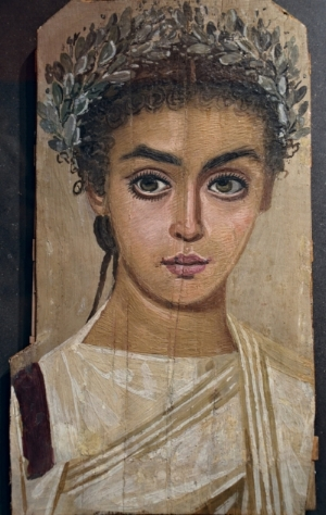 Mummy portrait of a girl, 120-150 CE, Roman Egypt, wax encaustic painting on sycamore wood (Liebieghaus, Frankfurt am Main).
