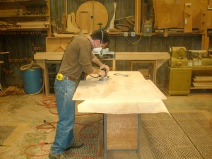 Randy sanding a panel to smooth perfection