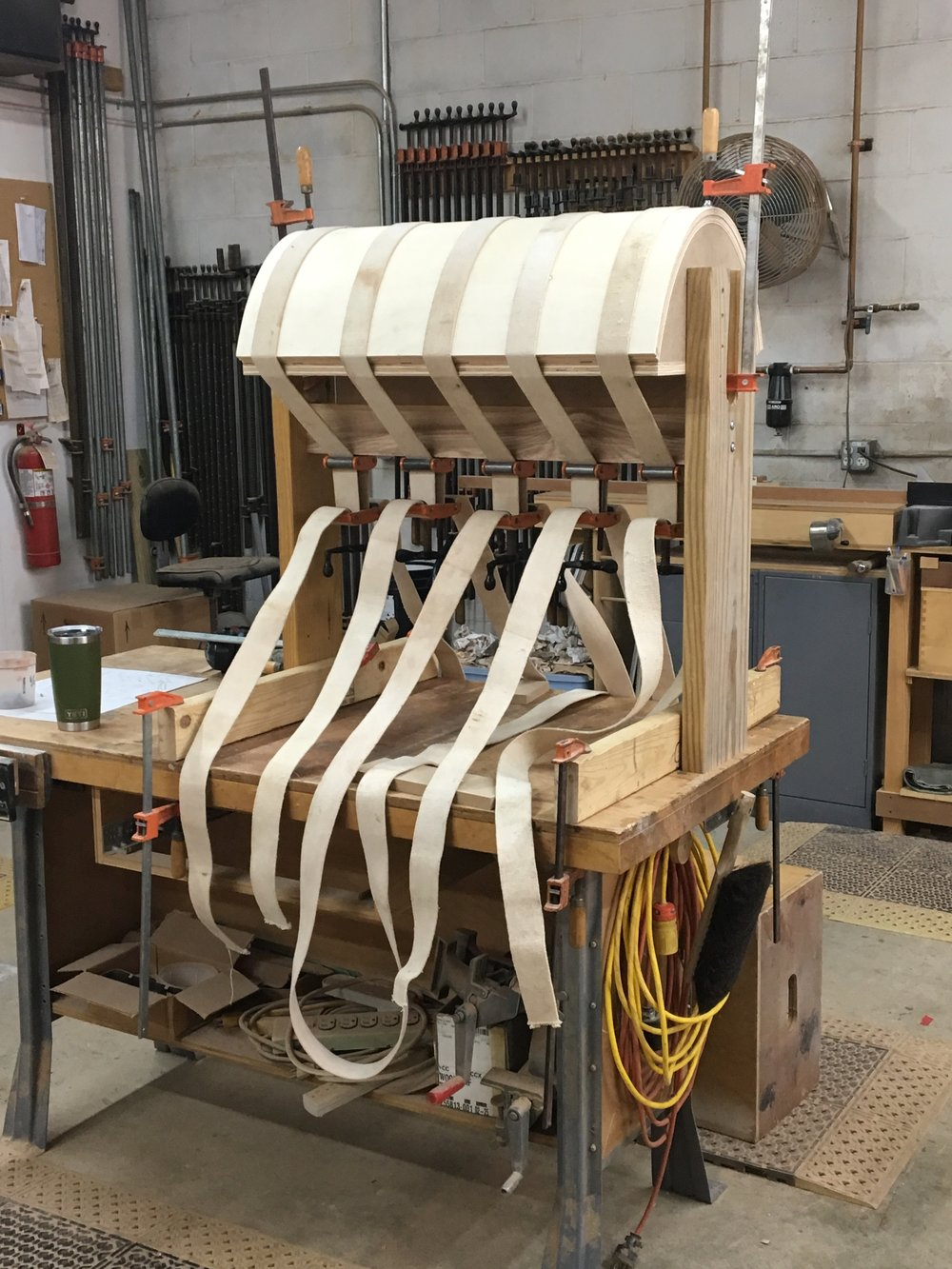 This is a photo of the form with the bending grade plywood being pressed against it with canvas straps.