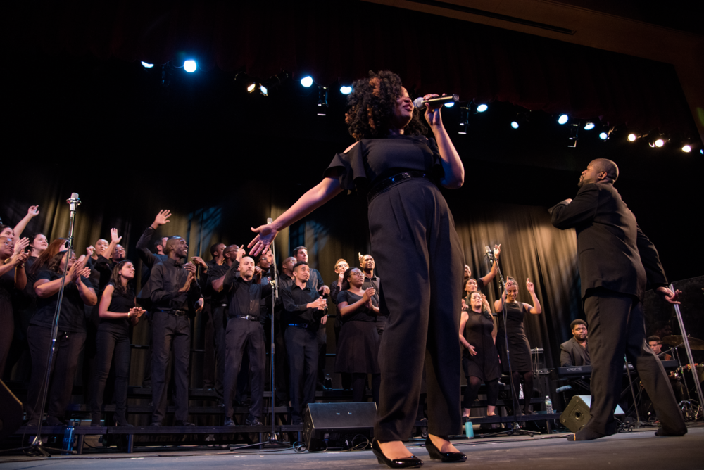 Wiljeana leading the Kuumunity Collaboration Choir and audience in a joyful song.  Photo credit: Peter Ricci