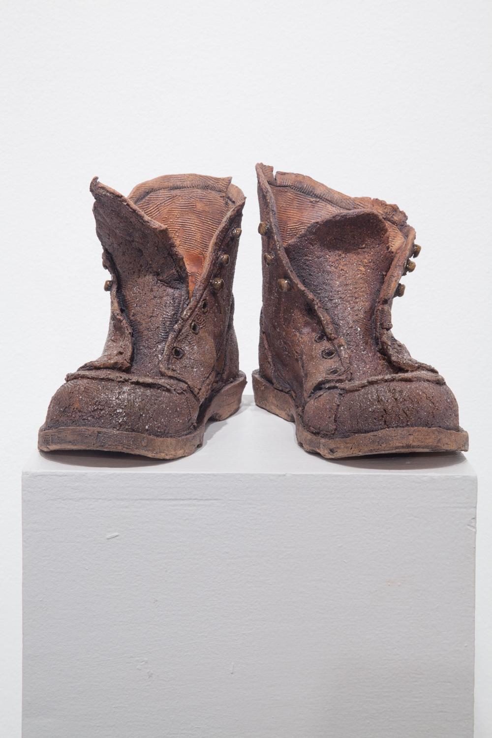 Claire Shurley     Papa's Work Boots     reclaimed stoneware, dirt from Shurley farmland,black stain, iron oxide, glaze, cone 6 oxidation