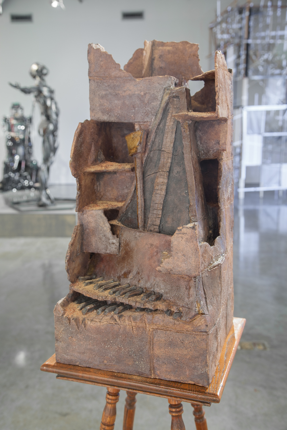 Claire Shurley   Mason and Musician with Metronome, Organ, & Bricks:  Papa   reclaimed stoneware, dirt from Shurley farmland, iron oxide, black stain, glaze, cone 6 oxidation