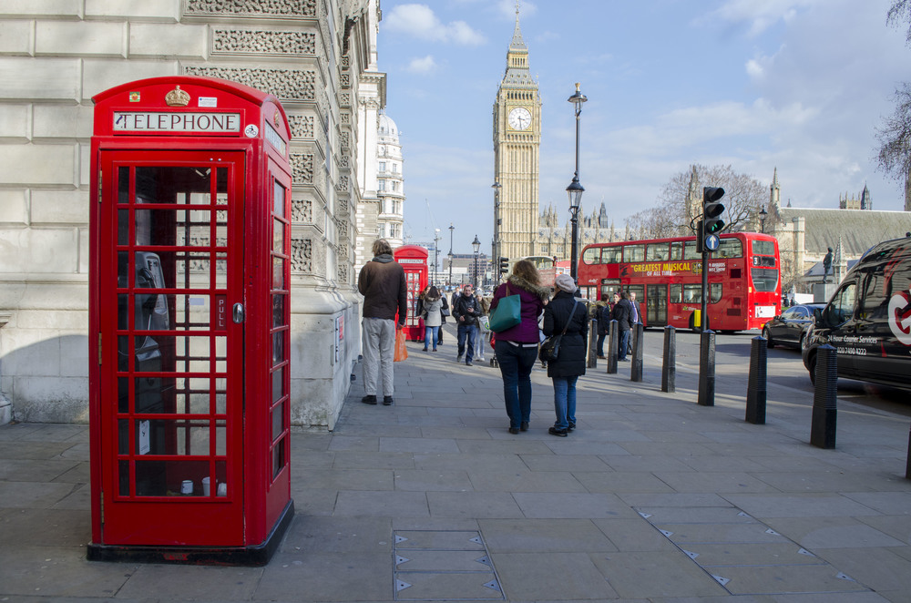 Red telephone booth by Big Ben.