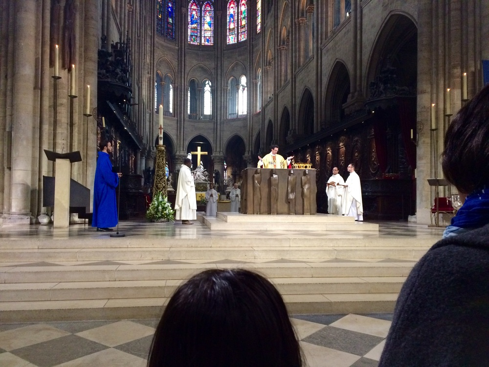 Finally in the second row during Easter Mass at Notre-Dame.