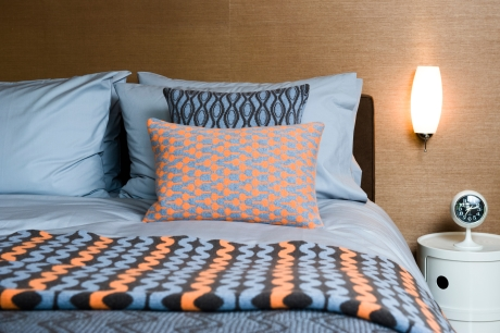 Geometric wool blanket and cushions by Seven Gauge Studio