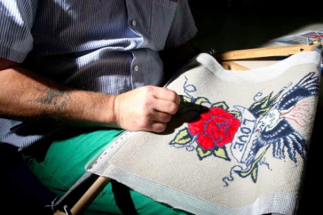 Stitcher working on a Tattoo cushion
