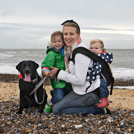 Cosima Pole with her two girls and her black labrador on the beach