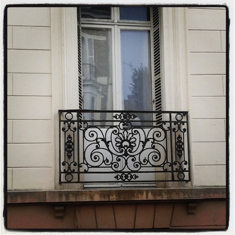 Ornate window guard in Dinard