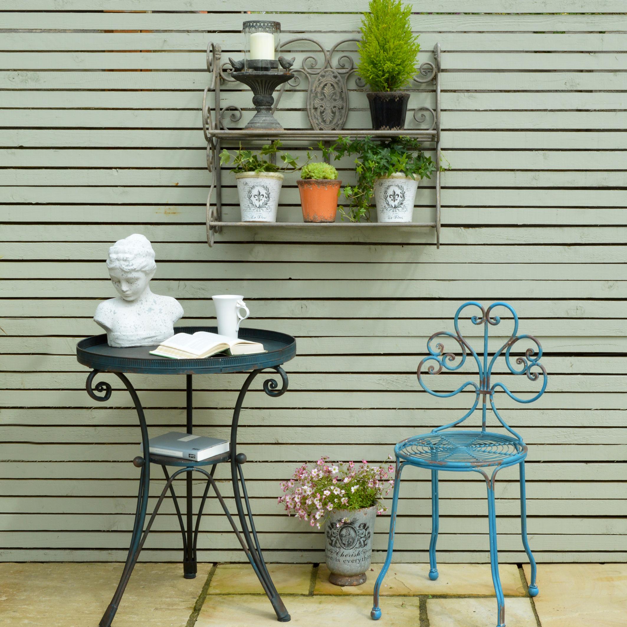 MiaFleur- Garden Wall Shelf £54.  Iron Garden Table £142. Iron Ornate Garden Chair £116. Accessories from £8.95
