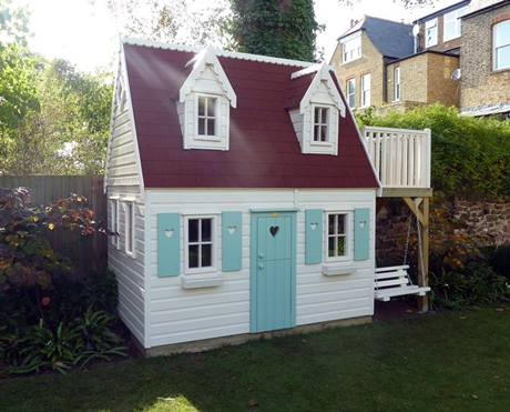 Playhouse with dormer windows by The Playhouse Company