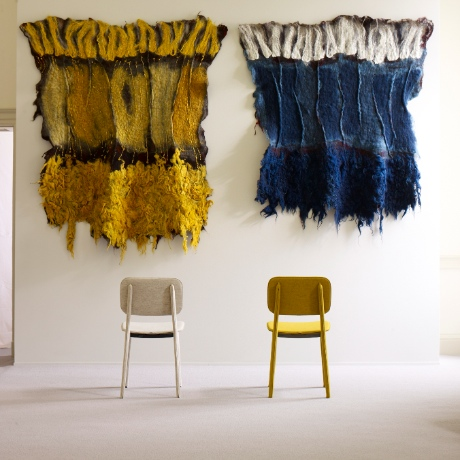Yellow and blue felt tapestries at Wool House