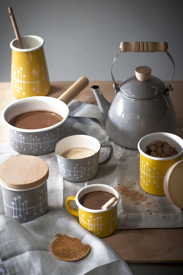 Enamel Muscat patterned mugs, £12.50 each, enamel stove kettle, £30, milk saucepan, £25, canisters £16.50, utensil holder, £14.50 and milk jug, £12.50.
