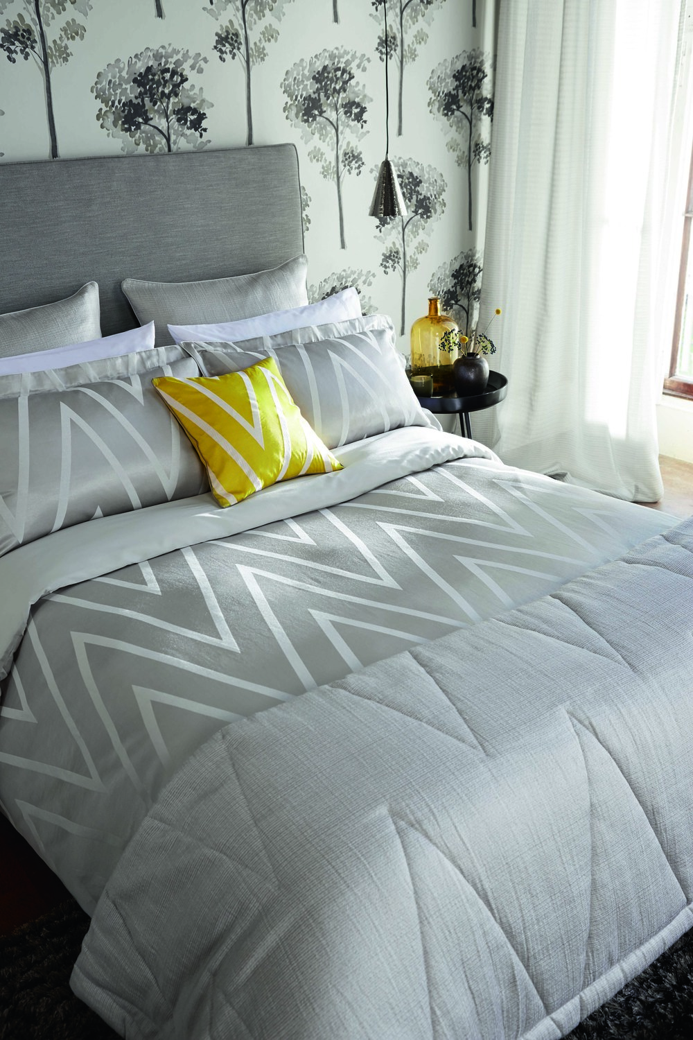 Bedlinen: Moriko Double Duvet Cover £120.00, Pillowcases: Moriko Square Pillowcase £30.00, Moriko Oxford Pillowcase £25.00, Cushion: £45.00, Throw: £175.00, Wallpaper: Katsura 110892 £59.00/rol