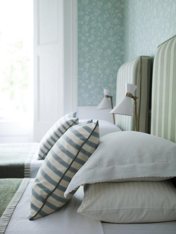 Ian Mankin - Green guest bedroom detail - Imperial Collection  -  Wallcovering Kew Mint - Headboards in  Oxford Stripe Sage - lifestyle - Portrait.jpg