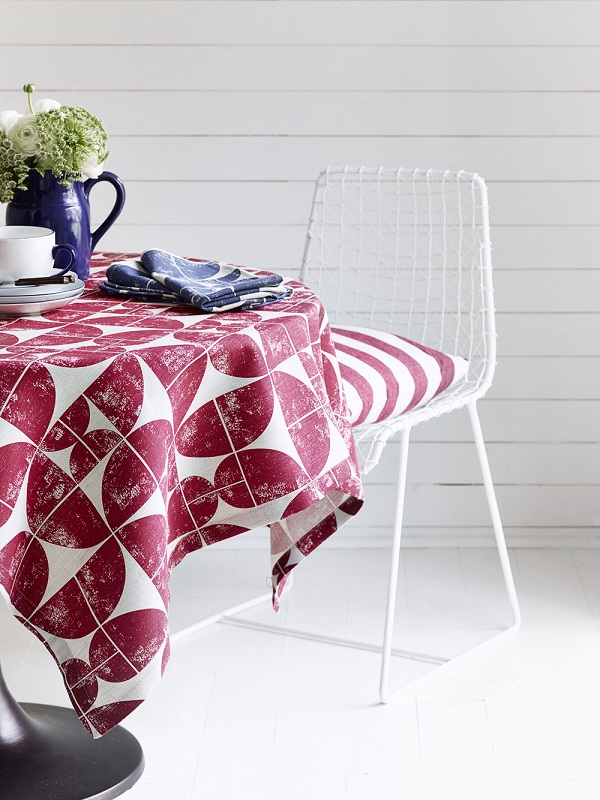 Tablecloth in Acton Peony, chair cover in Oxford Stripe Peony, napkin in Acton Navy