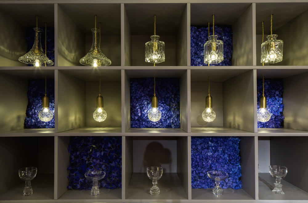Crystal Bulbs, Dcenaterlights and half Cut glasses surrounded by flowers