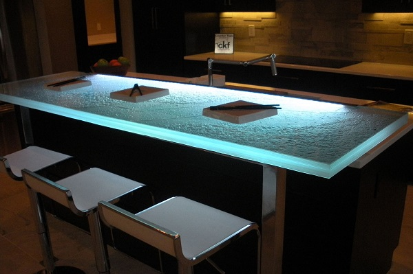 Another look at the same raised bar countertop seen above with lights dimmed and LED lighting on