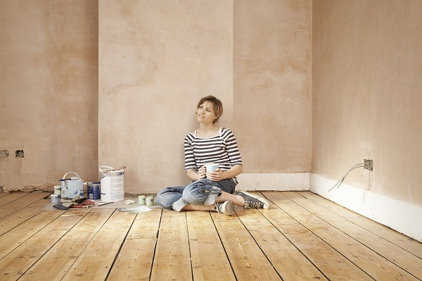 Woman With Coffee Mug Sitting On Floorboard