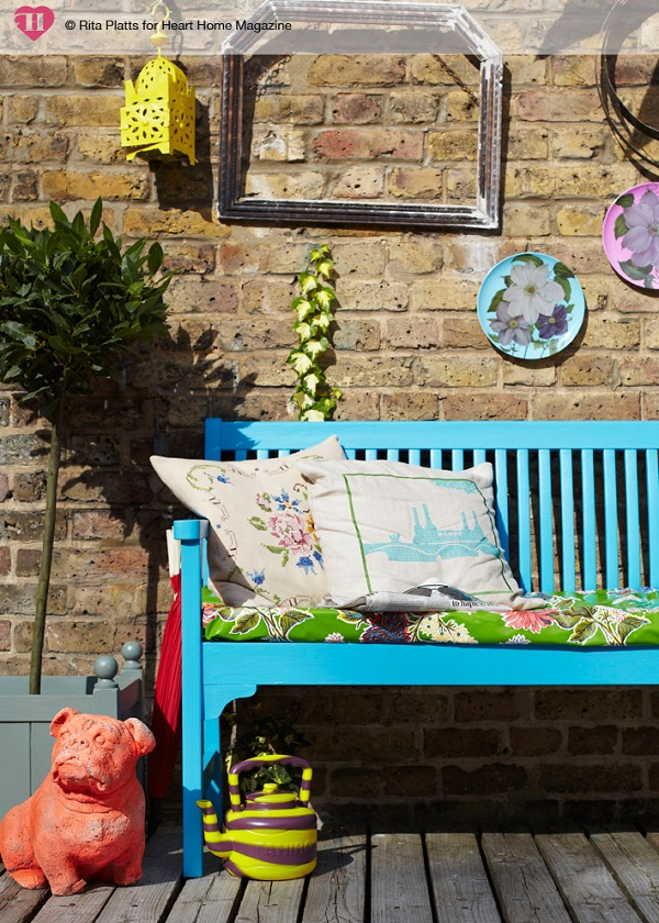 A bright splash of colour and some cosy textiles makes this seating nook sing.