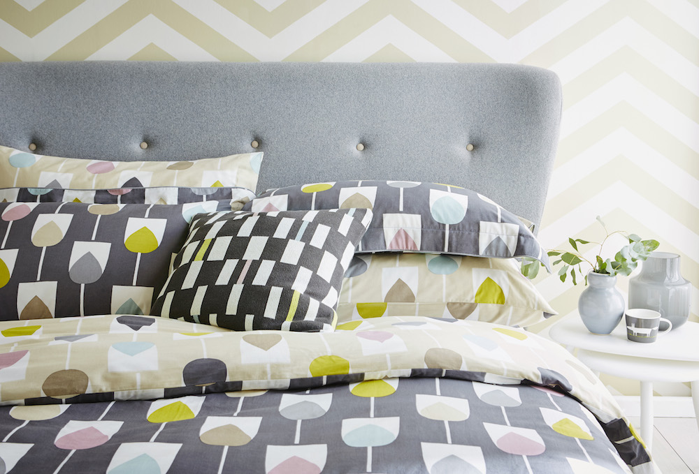 Sula Double Duvet Cover (200 x 200cm): £65.00; Sula Pillowcases: Oxford Pillowcase: £12.00 /each, Housewife Pillowcase £18.00 /pair; Cushion: Sula Cushion £25.00; Wallpaper: Lohko, Vector 111304 £49.00 p/roll; Mug: Mug: Mr Fox, Steel £10.00