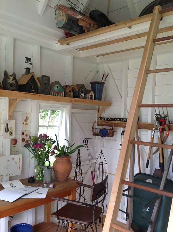 A moveable ladder provides easy access to the loft storage area.