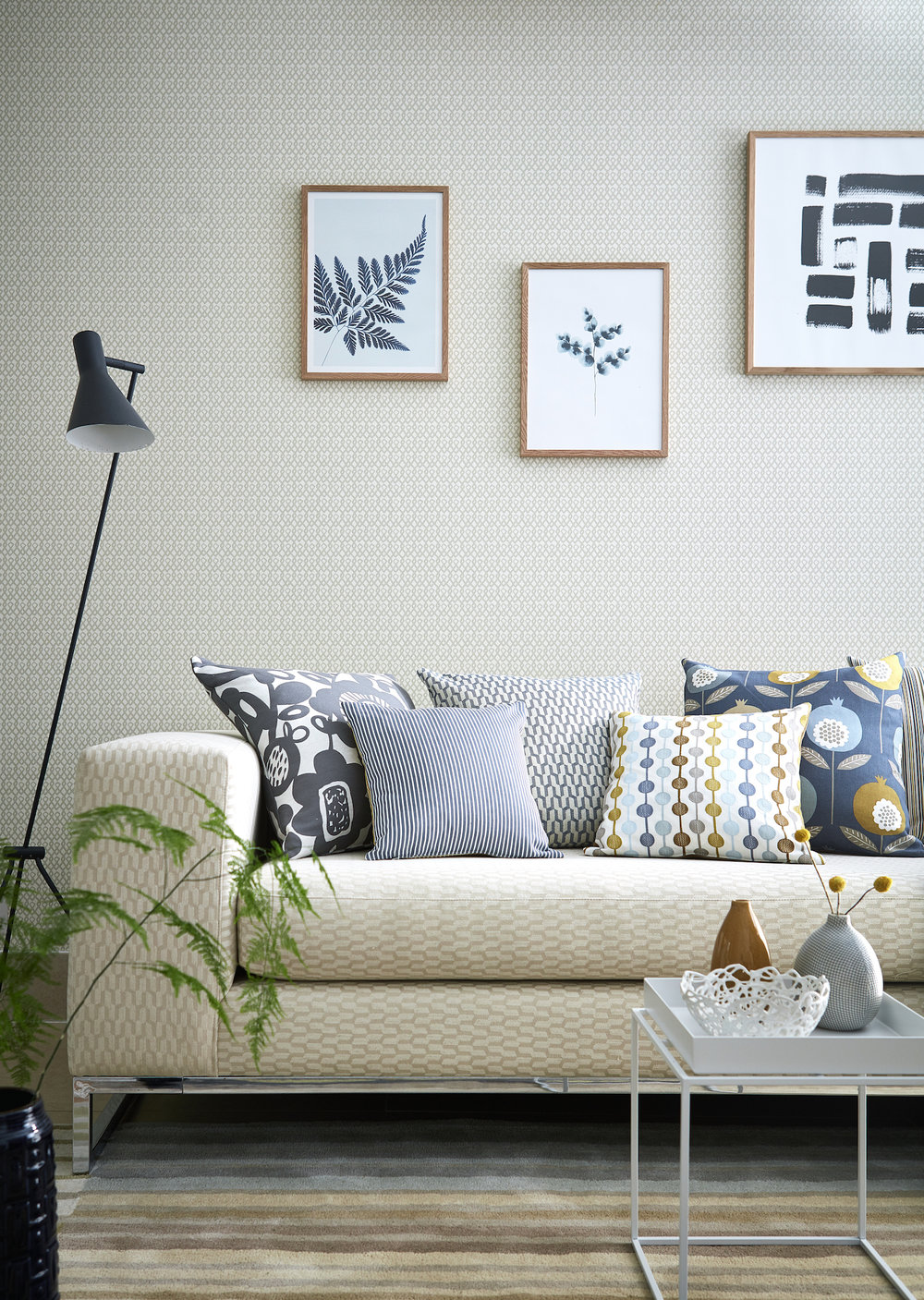 Wallpaper: Ristikko - £39 / roll; Sofa: Metsa - £39 / metre; Cushions: A selection of fabric from Pepino