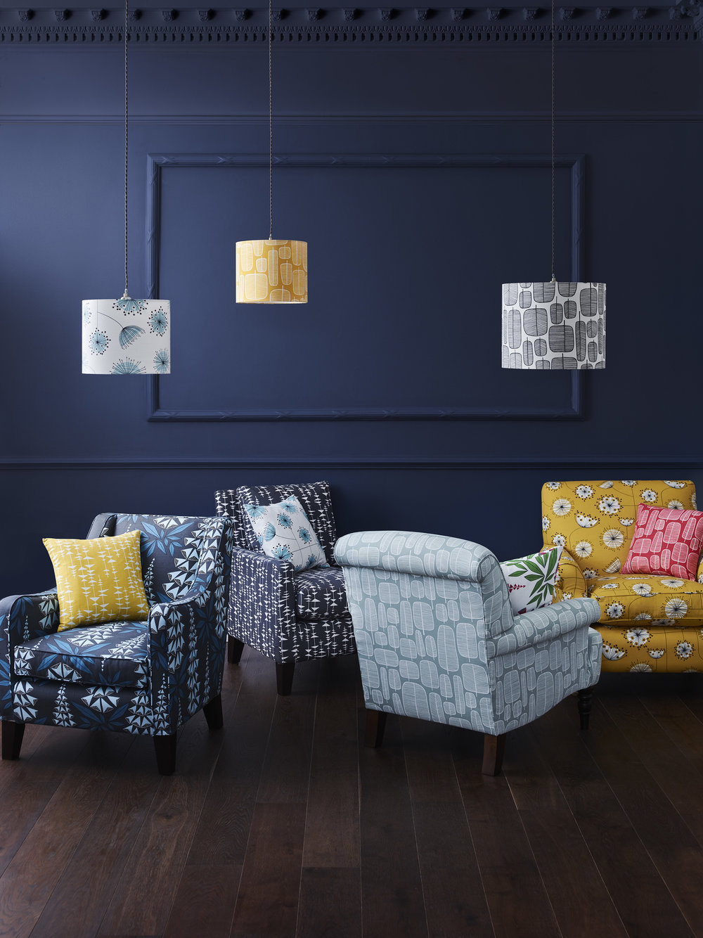 Alpine chair in Foxglove Boleyn Fabric £1129, Alfie Chair in Ditto Liquorice Fabric £1049, Ambleside Chair in Garden City Putty Rouge Fabric £1299, Halstead Chair in Dandelion Mobile Sunflower Yellow and White Fabric £889.